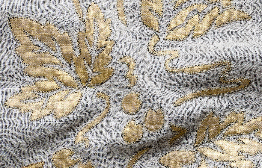 Gold painted linen applique on open-weave natural linen ground.